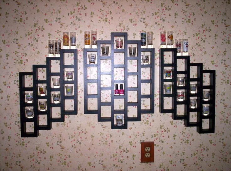 awesome shot glass display, for our ever growing collection. Don't think I'd display the nail polishes though