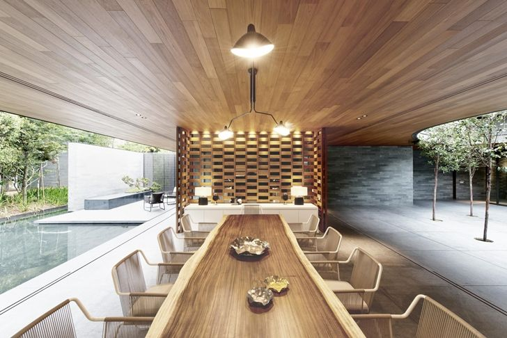 dinning area in the WALL HOUSE -Live with Nature - Modern Mansion in Singapore Embedded in Vegeation by FARM Architects