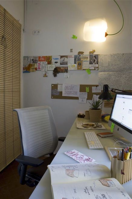"Hide it: In the home office of a couple's Barcelona apartment, the home office is well used but tidy, thanks to a roll-down window shade that conceals all detritus. The wall space is reserved for current projects and favorite things. The resident calls Steelcase's ""Think"" chair ""a masterpiece of cradle-to-cradle design—fully recyclable and very comfortable."" The desktop is a large piece of salvaged plastic. Photo by Carmen Masia Martorell.  Photo by: Carmen Masia Martorell"