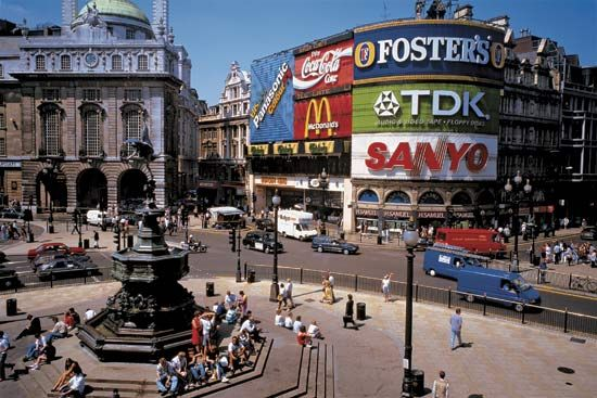 Photograph:A winged statue of Eros rises above Piccadilly Circus, the famous hub of entertainment and shopping in the West End of London. Several of the city's major streets—including Piccadilly, Regent, and Shaftesbury—converge at the site.