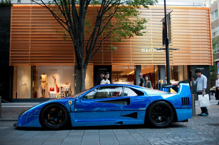 a beautiful blue ferrari f40 (parked outside Hermes of course ...