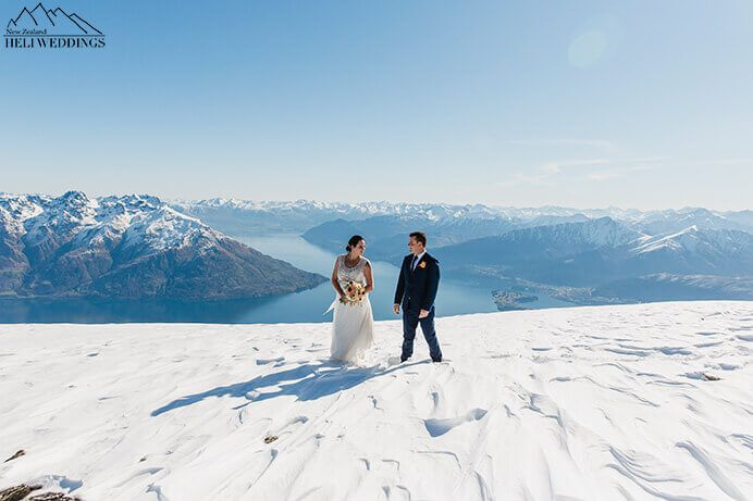 Wedding photos of bride and groom on The Remarkables. Destination Heli weddings Queenstown.