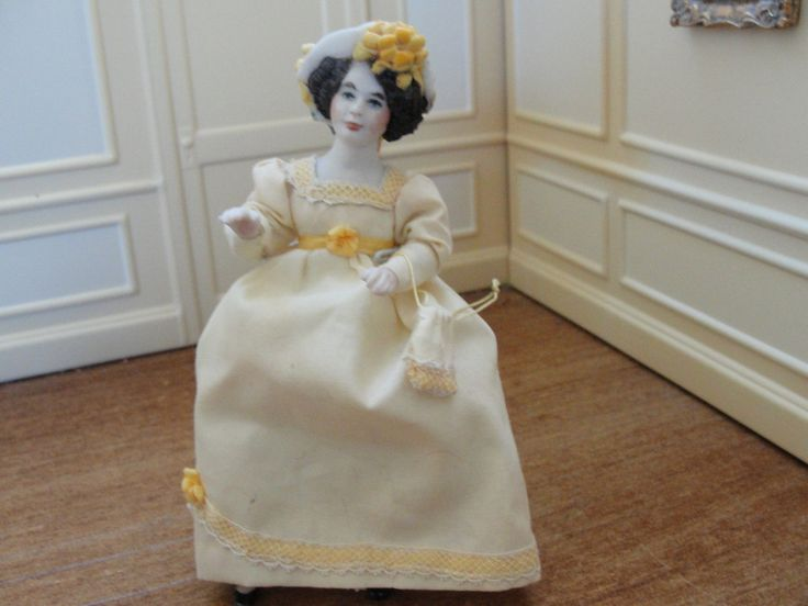 Marty Saunders, IGMA fellow - porcelain figure dressed in yellow with yellow lace. She carries a small yellow drawstring purse on her arm. She wears white pantaloons and slip. made in 1978. sold on ebay for $40.95