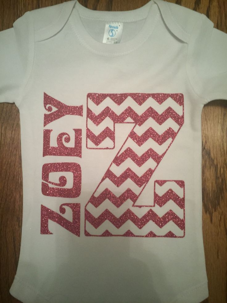 Personalized baby onesie with name and initial with Siser glitter heat transfer vinyl.