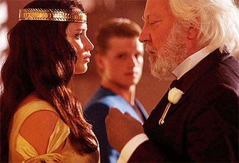 Katniss Everdeen Talks To President Snow As Peeta Looks On In This Still From The Hunger Games: #CatchingFire