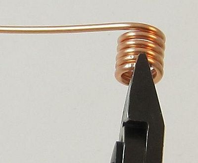 How to make your own jump rings for jewelry out of wire. Good description on how to use flush cutters properly.