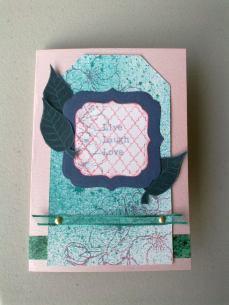 Tag card made with Dylusions spray, shield die, leaf and cherry blossom stamps.