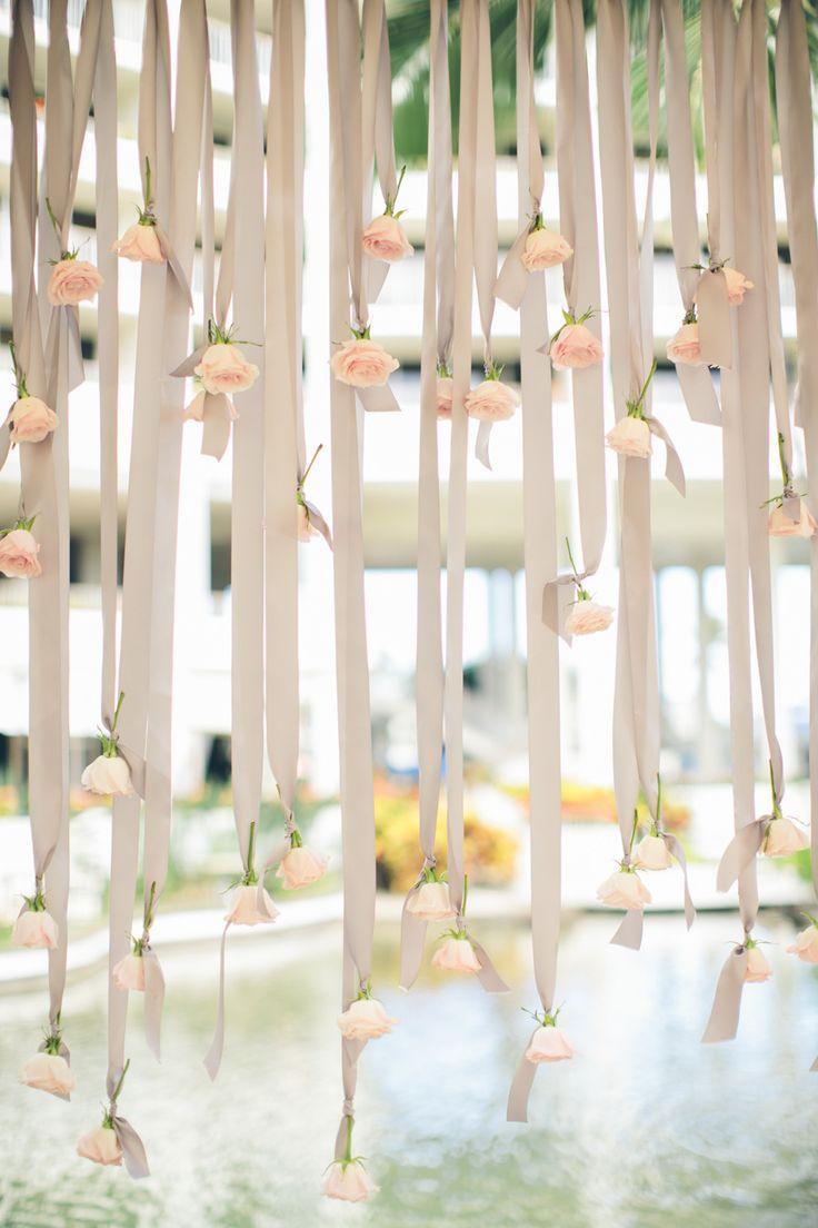 Ribbon and rose backdrop: http://www.stylemepretty.com/destination-weddings/2015/03/16/elegant-new-orleans-inspired-hawaiian-wedding/   Photography: Rebecca Arthurs - rebeccaarthurs.com