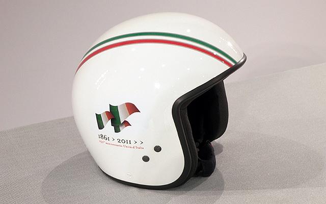 Vintage green vespa helmet shaking, support