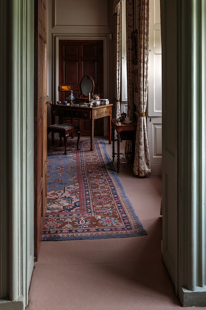 the moody view into a room with dressing table. Mompesson House,Wiltshire
