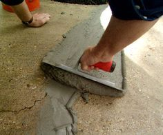 Once the cracks and other damaged spots have been filled, use the trowel to remove excess concrete and smooth the surface.