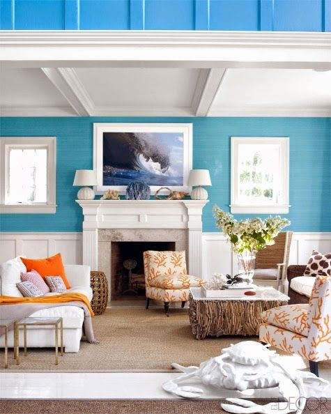 A Colorful Beach House Living Room Inspired by the Beach and Surfing. Via: http://www.completely-coastal.com/2014/08/colorful-beach-house-hamptons.html