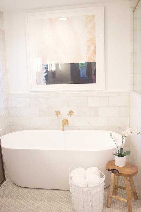 Spa Like Bathroom With Oval Tub And Wall Mount Gold Tub