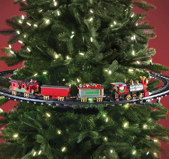This Christmas tree toy train attaches to the trunk of a Christmas tree and encircles the evergreen while spreading holiday cheer.