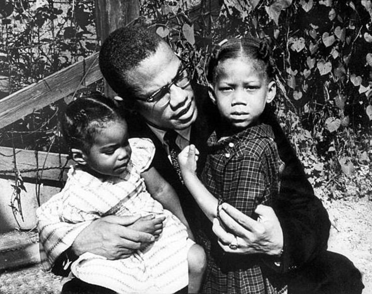 Malcolm X with his daughters Qubilah Shabazz (left) and Attallah Shabazz (right) at their home in East Elmhurst, Queens, 1962. Photos by Robert L. Haggins