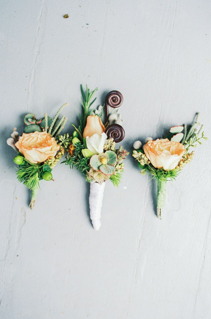Boutonnieres   On SMP: http://www.StyleMePretty.com/2014/03/04/coral-wedding-at-mountain-magnolia-inn/ Photography: D'Arcy Benincosa