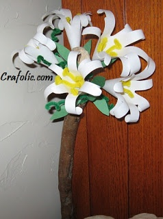 "St. Joseph Feast Day ~ Flowering Staff Craft. "" Some images and statues of Joseph show him with a staff which is topped with lilies. This is a symbol to remind us of a possibly true story which told of how Mary's spouse was chosen:  Walking sticks of widowers in Israel were collected and one was to be chosen from among them. The owner of the chosen staff was to marry the young virgin Mary. Joseph's staff burst into blossom, thus identifying him as divinely chosen."""
