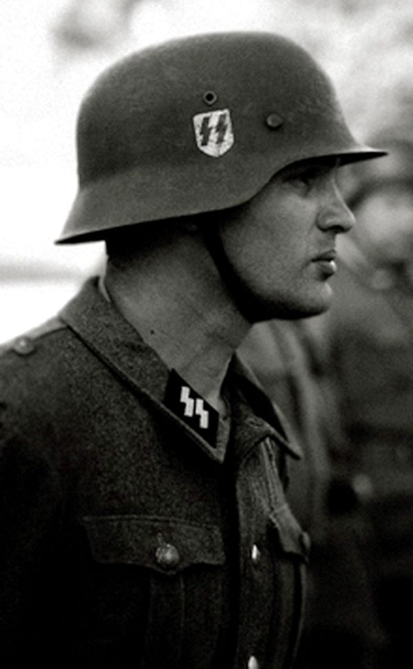 "A great Example of the High Standards expected of the S.S. however later on HIMMLER created divisions that one would NOT associate with the Nordic ideal such as the Muslim ""Hanschar"" division  these Divisions were not permitted to ware the ""dribble lighting bolt "" runes on their collar and instead had to ware a similar insignia on the left side of the tunic."