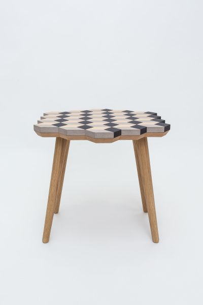 """This exclusive """"DIP STOOL"""" is made from three monochrome colors of veneer wood. It is uniquely created by assembling geometric pieces together, portraying a fascinating 3D illusion. This handmade crafted multipurpose stool has soft edged oak legs which encompasses an overall vintage feel.  Dimensions: W 48cm D 47cm H 45cm Materials: Black, gray and cream colored wood veneer and oak"""