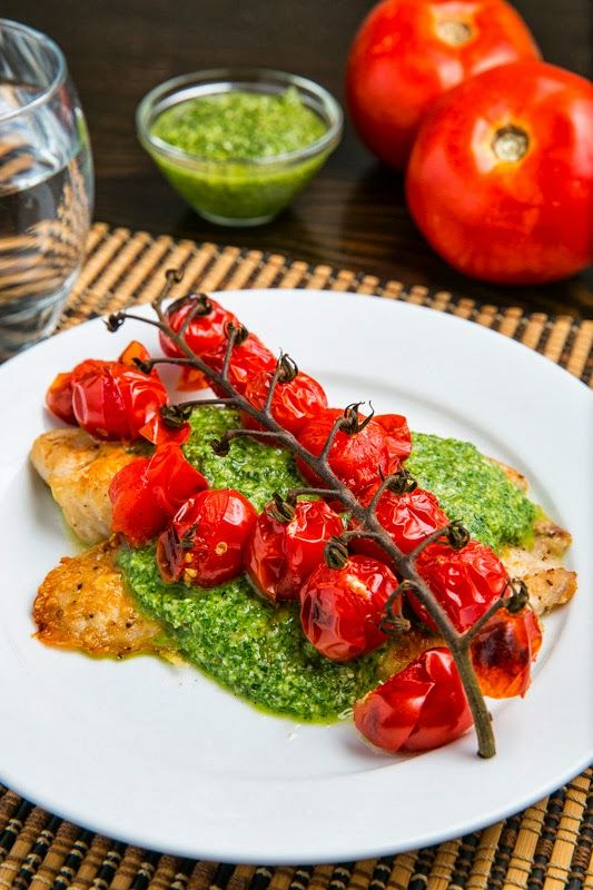 Parmesan Crusted Pesto Tilapia with Roasted Tomatoes | A light, simple and delightful tilapia fillet topped with melted parmesan, basil pesto and roasted tomatoes.