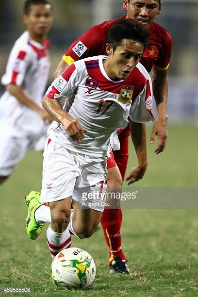 Vilayout Sayyabounsou of Laos runs with the ball during the 2014 AFF Suzuki Cup Group A match between Laos and Vietnam at the My Dinh Stadium on...