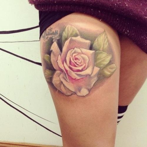 Cute pastel pink rose thigh tattoo