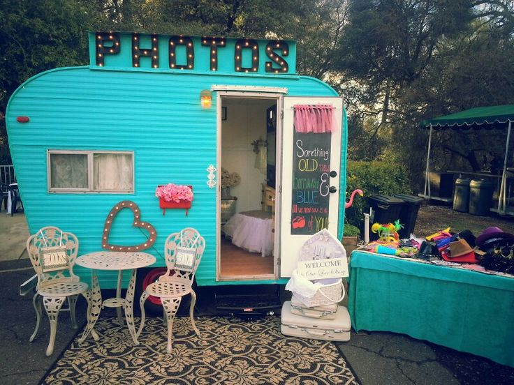 Grab a prop and strike a pose...inside this FUN vintage trailer photo booth! www.ourdiylove.com