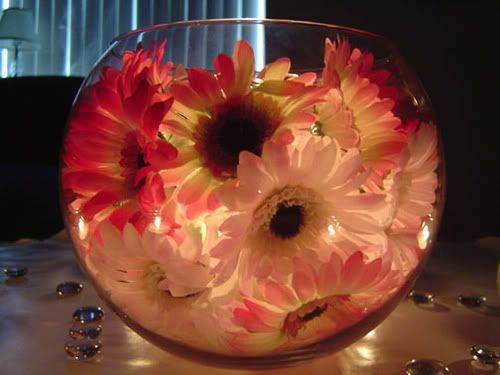 centerpeices with NO candles:  hide a battery powered tea light with flowers. This could be totally done from dollar store materials!