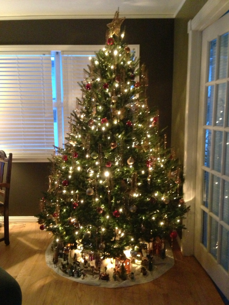 Ready for the holidays. Tree is complete now the little village is under the tree. Love this!
