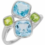 Two 7.00 mm Blue Topaz Antique Square Cut Faceted Gemstones and Two 4.00 mm Peridot Antique Square Cut Faceted Gemstones Are Arranged in a Unique Contemporary Design in This Bezel Set Sterling Silver Fashion Ring. With A Gorgeous Pairing of the Bright Spring Colors of Pastel Blue and Lime Green, This Amazing Ring is a Great Way to Accessorize With Color.NOTE: The very facets that create the beautiful sparkle in a loose gemstones or gemstones set in jewelry may create optical illusion white…