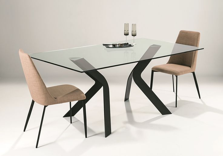 Duel Dining Table - solid and dramatic metal pedestals in textured matt black finish, supporting 12mm tempered clear glass top