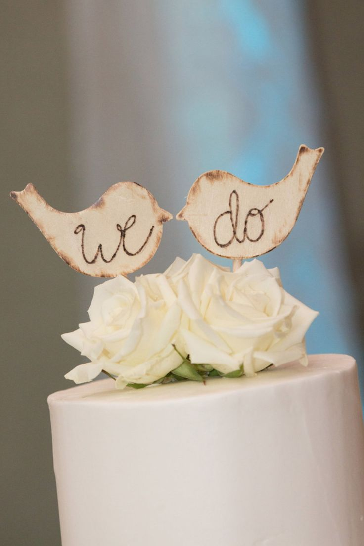 These wooden love birds from RusticDarlingCottage shop are quite the pair! With wood burned edging and lettering, they make a great topper for your rustic wedding cake!