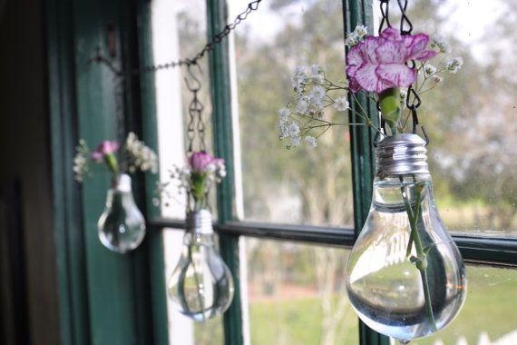 Light Bulb Vases (http://blog.hgtv.com/design/2013/08/02/daily-delight-light-bulb-vases-2/?soc=pinterest)