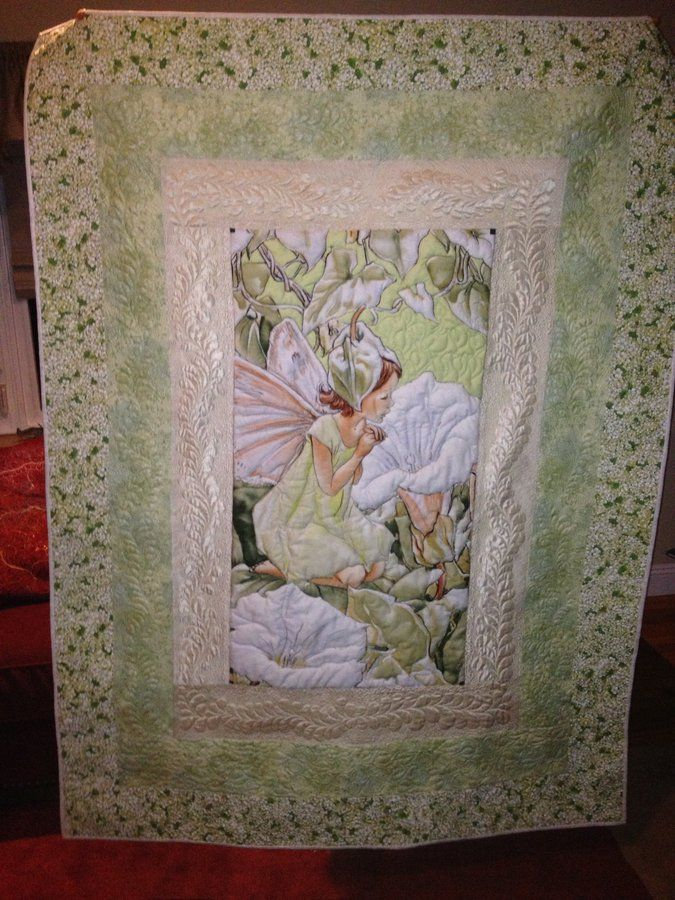 Flower Fairy. A simple panel, with lovely quilting in the borders.  From The Quilt Show gallery page.