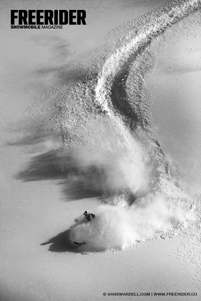Rob Alford riding deep powder in the backcountry of Revelstoke, British Columbia, Canada. Photo Hans Wardell. Freerider Snowmobile Magazine