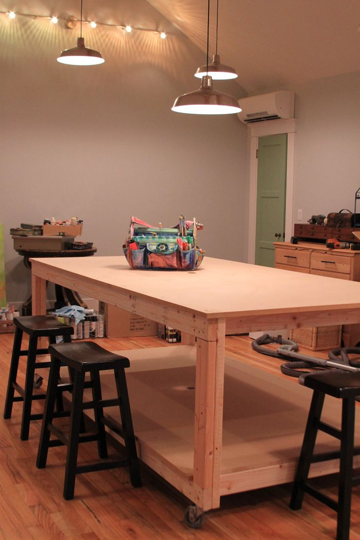 "From the blog ""Close 2 my art,"" an amazing table the blogger/artist's husband built for her. It can be wheeled out of the way, plus there are holes to allow for cords into the plug in the middle of the floor. So smart! Click for more pictures. (Michelle allen artist studio vancouver)"