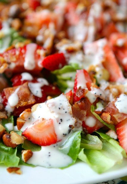 Strawberry Bacon Salad with Greek Yogurt Poppyseed Dressing  for the salad 1 head romaine lettuce or 6-8 cups baby spinach 2 cups sliced fresh strawberries 1/4 cup toasted almonds, chopped 8 slices bacon, cooked and crumbled  for the dressing 1/2 cup greek yogurt 1/2 cup mayonnaise 1/4 cup white vinegar 4 tablespoons sugar salt & pepper, to taste 1 teaspoon poppyseeds