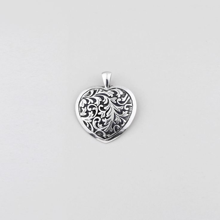 EN1214 Burnished #silver heart #pendant featuring #floral arabesque detail - www.miglio.com