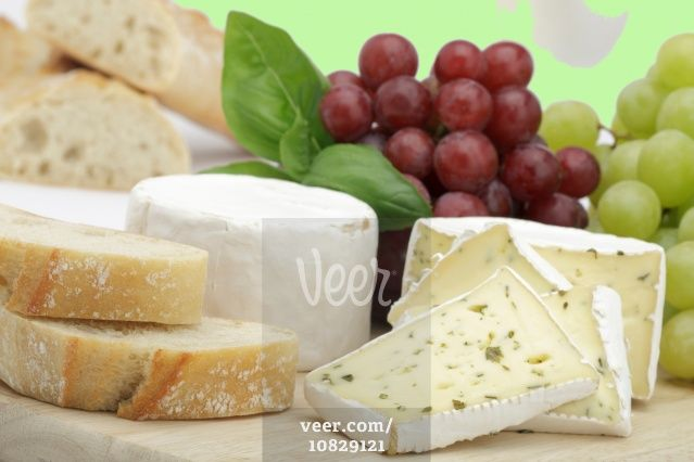 Cheese plate with grapes and bread Stock Photo