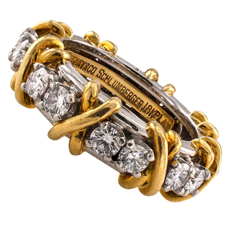 Tiffany & Co. Schlumberger 16 Stone Diamond Gold Platinum Eternity Ring | From a unique collection of vintage band rings at https://www.1stdibs.com/jewelry/rings/band-rings/
