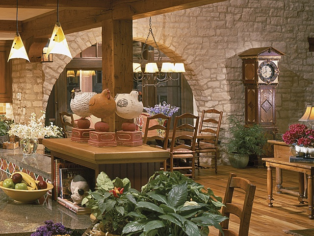 Traditional kitchen with large dining room and stone wall for Eldorado stone kitchen