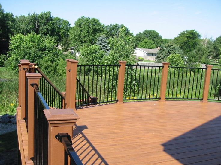 Covered plan deck railing timbertech teak deck for Fortress fence design