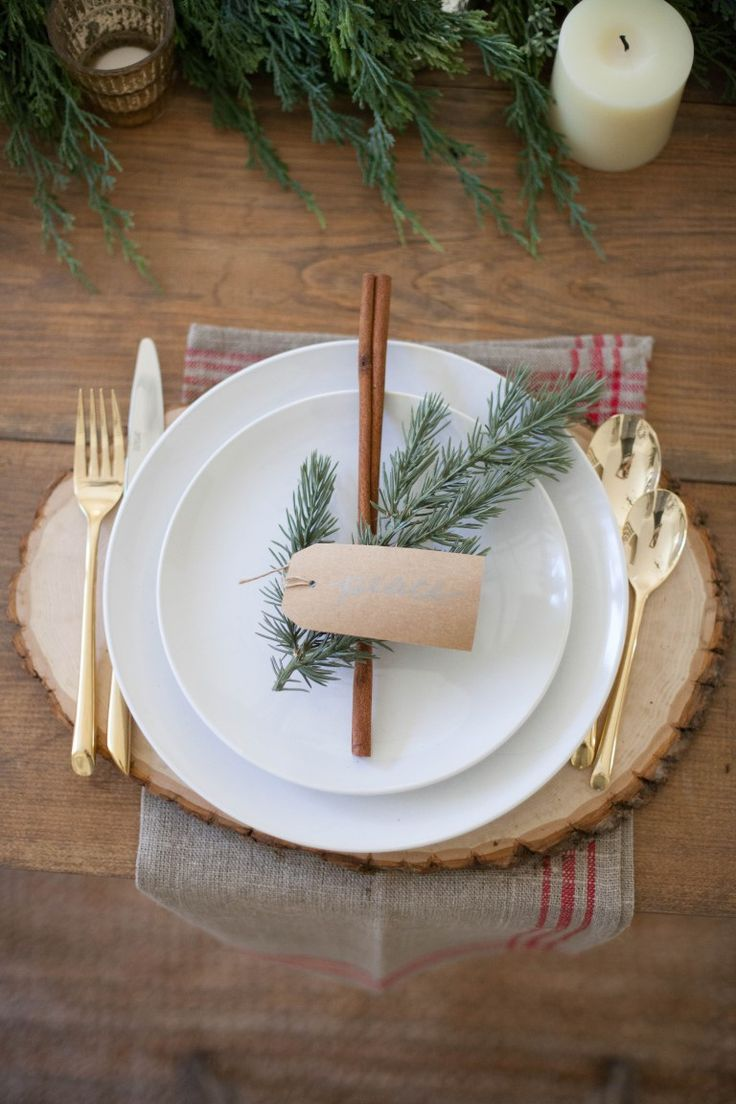 A beautiful farmhouse Christmas tablescape with rustic elements, mixed metals, a…
