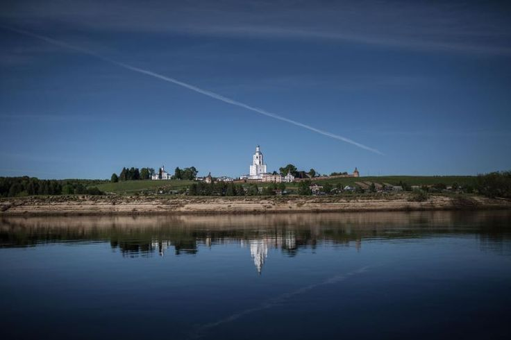 Reflections of the Ulyanovsky monastery, almost destroyed during the Soviet time, are seen along the banks of the Vychegda River, in the village of Ulyanovo in the Komi Republic, June 2014.