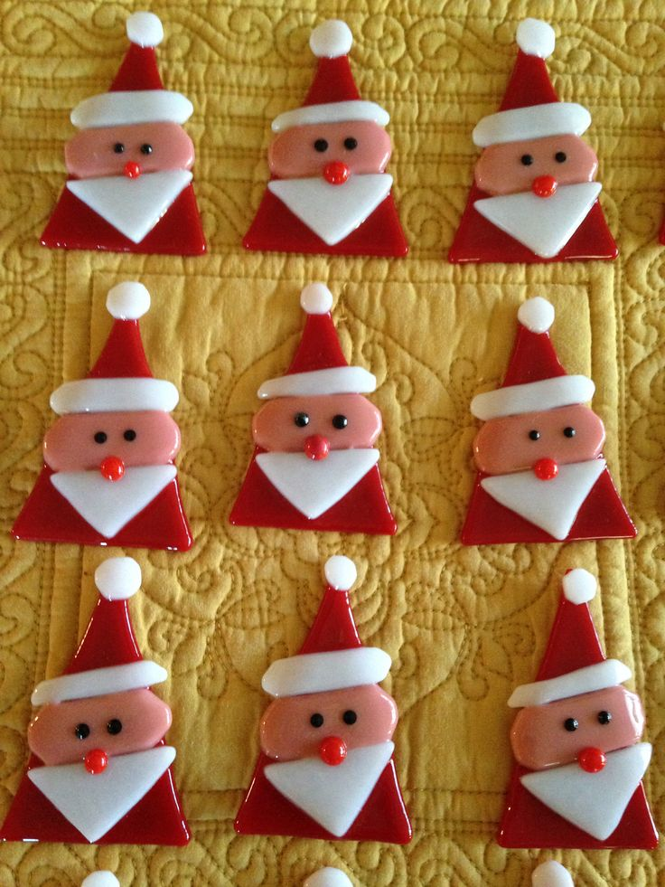 Santa Ornaments fresh out of the kiln.  3 inches by 2 inches soft fused by Kim Natwig.