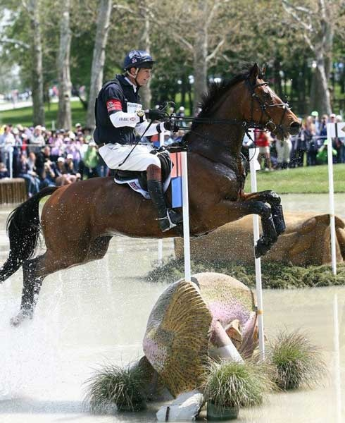 Rolex Horse Jumping Over A Fish