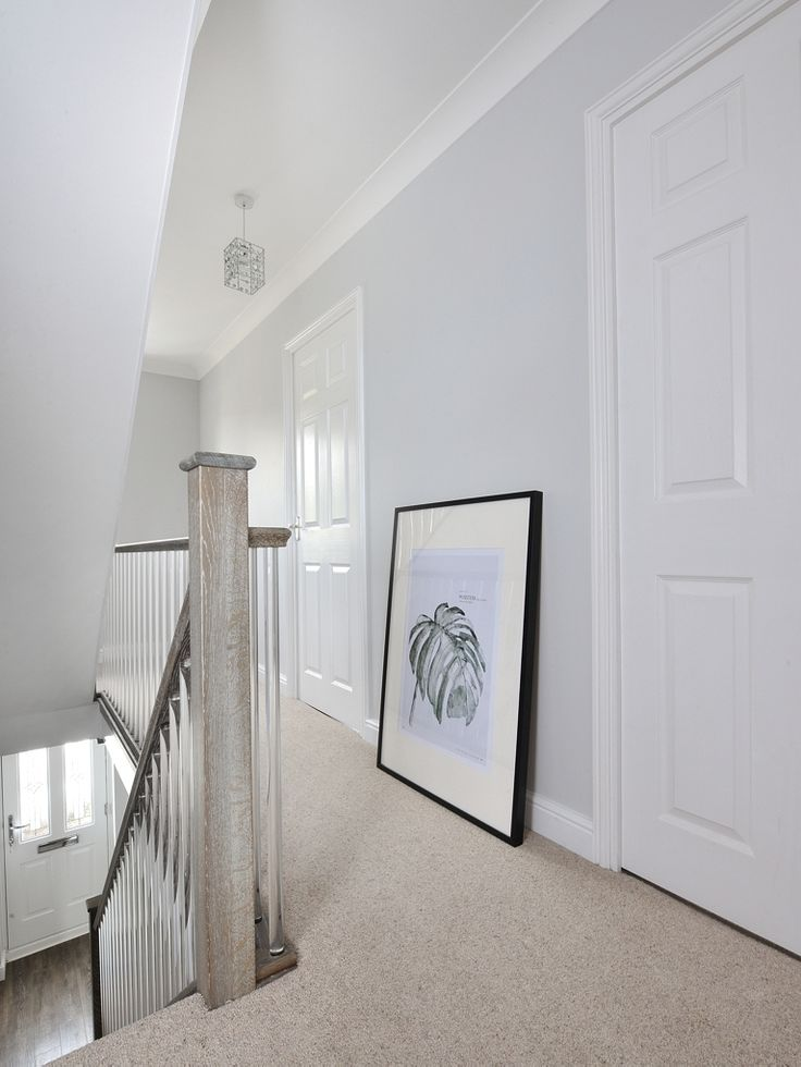 We were given a very specific challenge by The Ramsden Family. We had to match our solid oak newels, hand rails and base rails to the existing laminate floor! Also to make it more bespoke, a new style of clear spindle had to be sourced! The end result is very unique and bright, don't you agree? We love the lead wall art they sourced too!