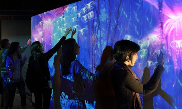 SocialScreen uses your body's image to interact with an immersive wall projection wherein visitors can move and manipulate a variety of customized virtual objects and scenarios, tailored to fit the needs of your brand, exhibit or promotion.