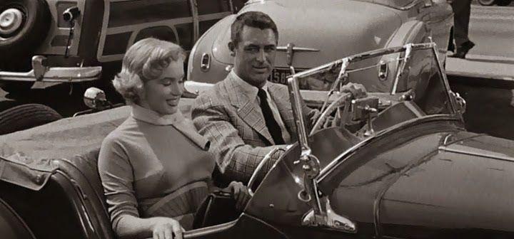 Lois Laurel  [Marilyn Monroe] y  Barnaby Fulton  [Cary Grant]