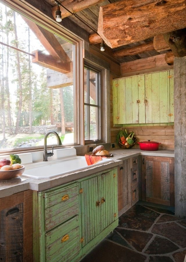 This rustic kitchen is really cool, especially the weathered kitchen sink color.. whatever it is!